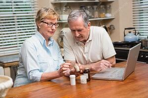depositphotos_60839255-stock-photo-senior-couple-looking-up-medication